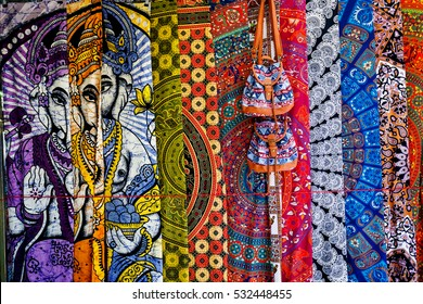 Range of colorful sarong hanging in the shop. India style scarf and bags.
