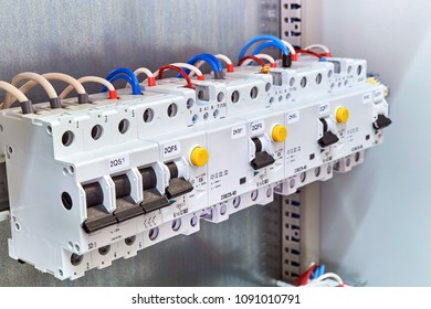 A range of different modular electrical devices in an electrical Cabinet. Circuit breaker, protection device of the differential current, modular contactor is wired according to the diagram.