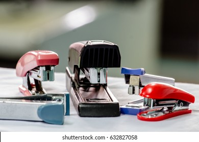 range of different office Staplers, selective focus whit blurry background