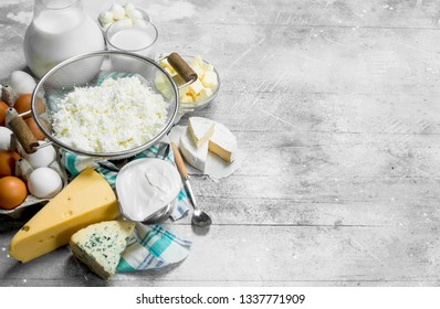 The range of different types of dairy products . On a rustic background.