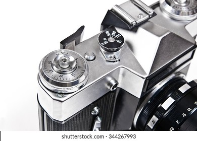 Range finder camera with lens. Close up view part of old retro photo camera. Classic black manual film camera isolated on white background.