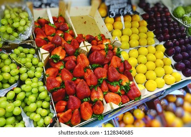 The range of fresh strawberry, grapes, nectarines, plums in the store