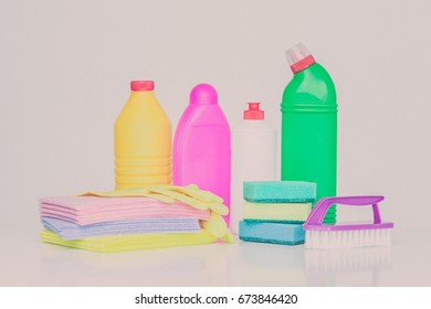 Range of household cleaners. Detergents, chemical bottles, cleaning sponges and gloves. on a white background