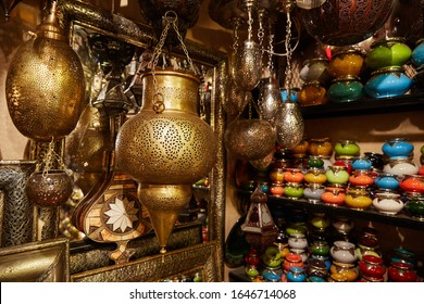 Range of lantern , mosaic lamp and oriental traditional lamp hanging in the market at Marakesh. Morocco. Oriental interior design