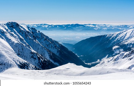 A range of Low Tatras in Slovakia seen from the summit of the Western Tatras in winter scenery.