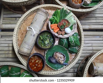 Range of north thailand food on traditional bamboo plate, detail of traditional thai food with lovely presentation and pretty background