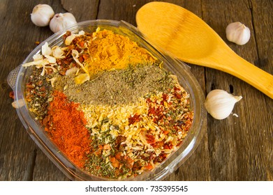 The range of Oriental spices with spicy chilli, curry and a mixture of other spices. Copy space, Old dark wooden background.