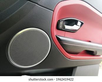Range Rover Evoque. Car door. The interior of the car. Car door speaker. Red leather in the interior.