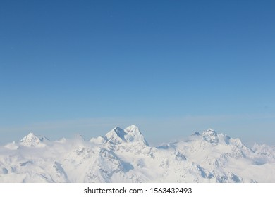 Range of winter mountain peaks at sunny day at Soelden Austria