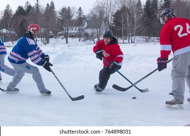 Rangeley, Maine/USA - February 4, 2017: Men's teams compete on the ice at the 11th annual New England Pond Hockey Festival on Hayley Pond in Rangeley, Maine.