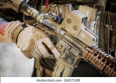 ranger in gloves holding assault automatic rifle