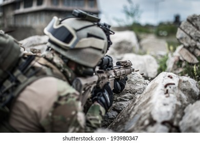 ranger on battle field, aiming on enemy, view from behind