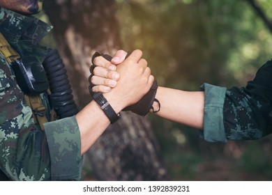 Rangers celebrating success, clapping with hands. Team work conceptual image. Soldier shaking hands . People and military concept