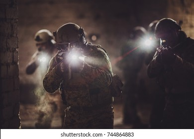 rangers during the military operation with laser sights and lanterns. Military and police concept.