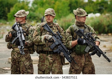 Rangers on patrol in destroyed city. Military and rescue operation concept.