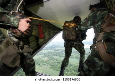 Rangers parachuted from military airplanes. Soldiers parachuted from the plane.