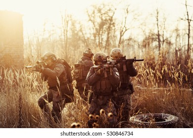 rangers  with a rifle aiming. battlefield concept. color  toned image.