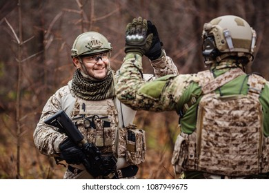 rangers shaking hands on outdoor background. victory and military concept