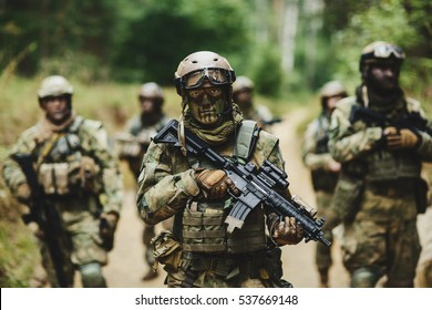 rangers standing with rifle and looking at the camera