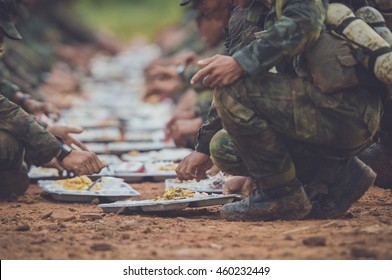 rangers team are heated food on the fire and eat in the forest  ,  rangers team are heated food on the fire and eat in the forest