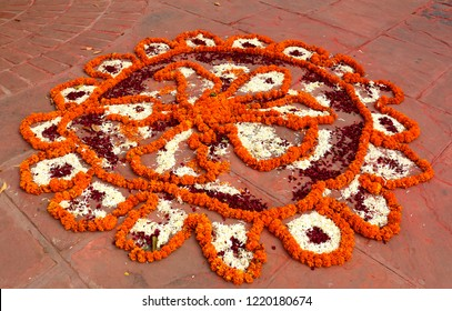 Rangoli is an art form, originating in the Indian subcontinent, in which patterns are created on the floor or the ground using materials such as colored rice, flowers , colours.
