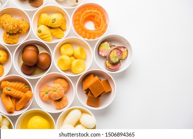 Rangoli of Assorted Indian sweets/mithai in bowl for Diwali or any other festivals, selective focus