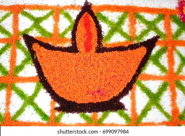 Rangoli of a lamp (diya) made from colored rice