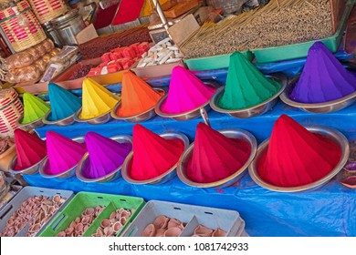 Rangoli powder, incense and joss sticks displayed in an Indian market. The colourants are used in Hindu forehead marking and for festivals such as Holi, as well as for making floor patterns, or Kolams