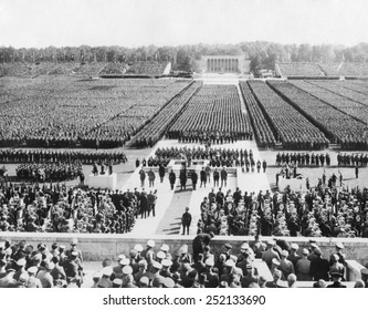 Ranks of the Nazi German army fill Zeppelin Field in Nuremberg. They are addressed by Hitler from a podium (center) during the Nazi Party Congress, Sept. 8, 1938.