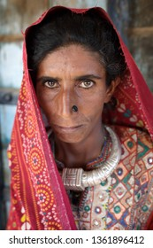 RANN OF KUTCH, INDIA - DECEMBER 7, 2018: Unidentified old Jat woman in a rural village in the district of Kutch, Gujarat. The Kutch region is well known for its tribal life and traditional culture.
