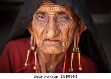 RANN OF KUTCH, INDIA - DECEMBER 8, 2018: Unidentified old Rabari woman in a rural village in the district of Kutch, Gujarat. The Kutch region is well known for its tribal life and traditional culture