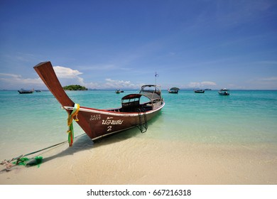 Ranong, Thailand - May 5, 2017 : A local long tail boat in the sea on the sunshine day waiting for the tourist