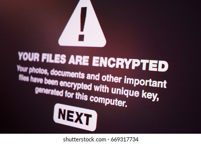 Ransomware - Close up of Your Files Are Encrypted on the Screen - Shallow Depth of Field