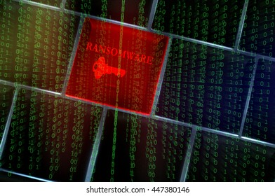 Ransomware concept with backlit laptop keyboard overlaid with binary codes