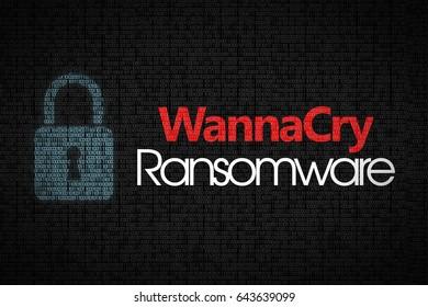 Ransomware WannaCry text on dark binary code background.