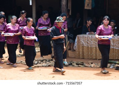 Rantepao, Sulawesi, Indonesia - November 11, 2016: Family of the deceased preparing to greet their guests at an elaborate funeral ceremony in Tana Toraja region in Sulawesi, Indonesia.