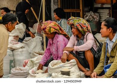 RANTEPAO, TORAJA,SULAWESI - OCT 21,2009: Toraja ethnic women sell rice during the market in Rantepao, Sulawesi, oct 21, 2009.
