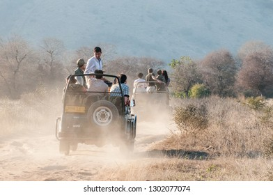 RANTHAMBORE, INDIA - FEBRUARY 4, 2011: Tourists enjoy a Safari drive on a dusty road. Ranthambore National Park is famous for its wildlife.