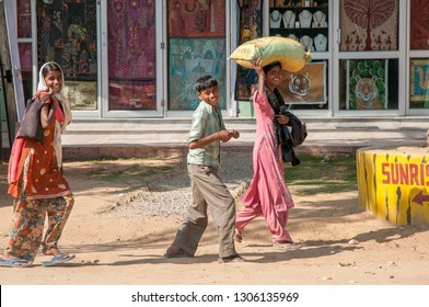 RANTHAMBORE, INDIA - FEBRUARY 4, 2011: Smiling Rajasthani kids on their way home from school. Rajasthani people are known as some of the most colorful people in India.