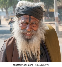 RANTHAMBORE, INDIA - FEBRUARY 4, 2011: Portrait of a smiling Rajasthani man in Ranthambore. Rajasthani people are known as some of the most colorful people in India.