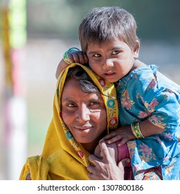 RANTHAMBORE, INDIA - FEBRUARY 4, 2011: Portrait of a Rajasthani mother with kid in Ranthambore. Rajasthani people are known as some of the most colorful people in India.