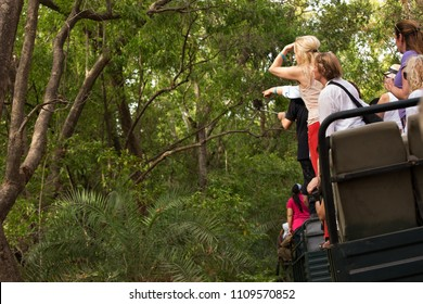 RANTHAMBORE, INDIA-MAY 05: Tourists on canter trying to have a glimpse of the tiger in the bushes at Ranthambore National Park, Sawai Madhopur, India on May 05, 2018