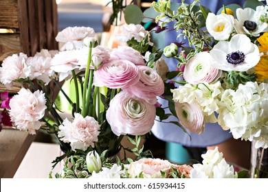 Ranunculus. A bouquet of beautiful flowers - buttercups. A shelf in a flower shop, flower fairs, a market.