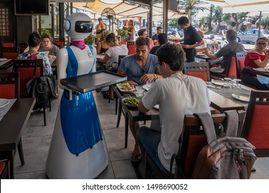 "RAPALLO, ITALY - JULY 25: Waiter robot brings the dishes on July 25, 2019 in Rapallo, Italy. The ""Gran Caffè Rapallo"" restaurant in Liguria is the first restaurant in Italy to use robot waiters"
