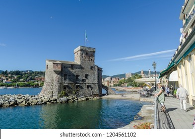 Rapallo, Italy - October 3, 2018: The old castle and the boardwalk in the city Rapallo by the mediterranean sea in the province Liguria in Italy