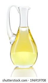 Rapeseed oil in decanter isolated on white background. Canola oil rich in Omega-3.