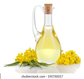 Rapeseed oil in decanter oilseed rape flowers and seeds isolated on white background. Canola oil.