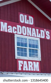 RAPID CITY, SOUTH DAKOTA - June 10, 2014:  The side of a traditional red and white barn with a window and sign for Old MacDonald's Farm in Rapid City, SD on June 10, 2014.