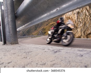rapid motorcyclists from the roadside with guardrail