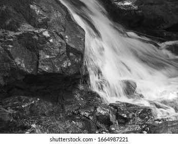 Rapid Mountain Falls Over Carved Rock
